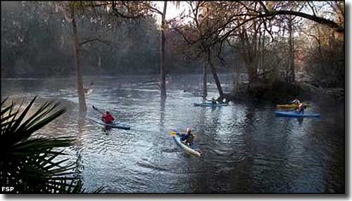 Kayakers entering the Withlacoochee River from Madison Blue Spring State Park
